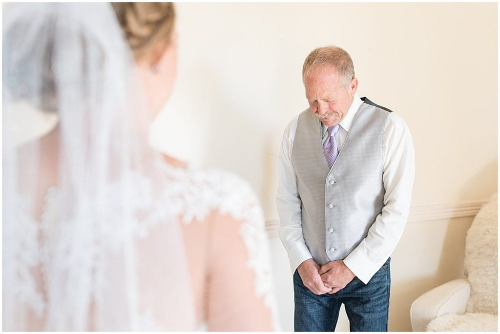 First look with father for wedding at Wagner Angus Barn in Wolcott, Indiana