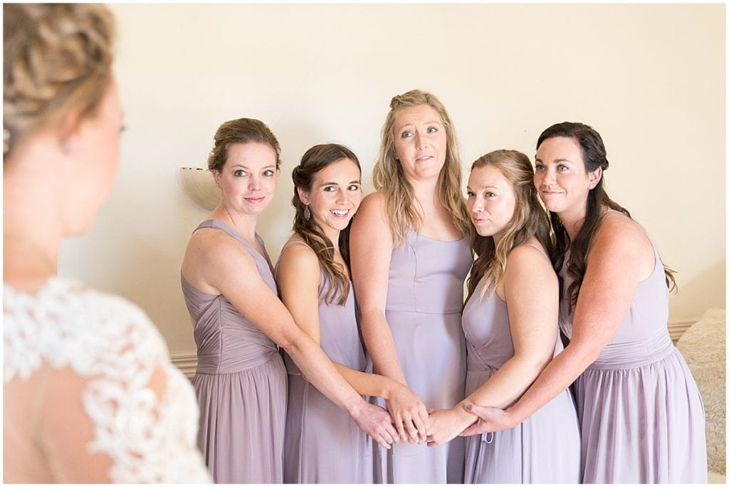 First look with bridesmaids for wedding at Wagner Angus Barn in Wolcott, Indiana