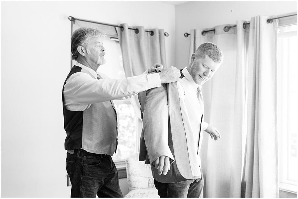 Groom getting ready for wedding at Wagner Angus Barn in Wolcott, Indiana