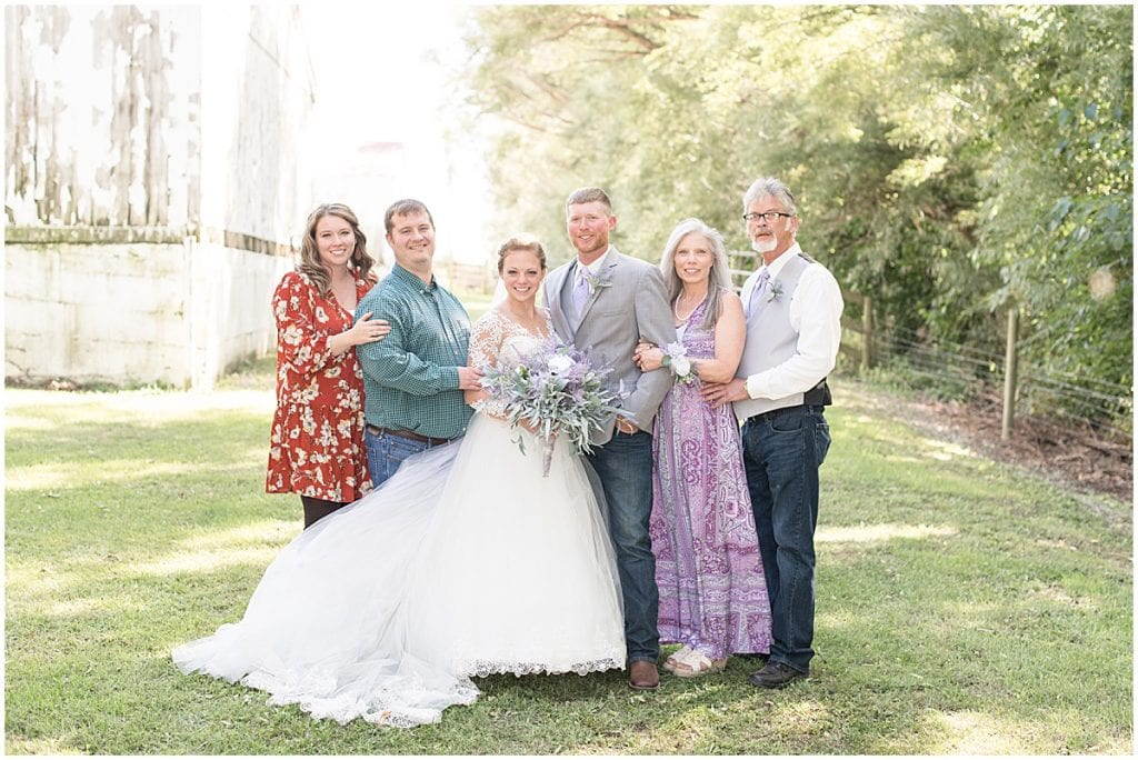 Family photos for wedding at Wagner Angus Barn in Wolcott, Indiana