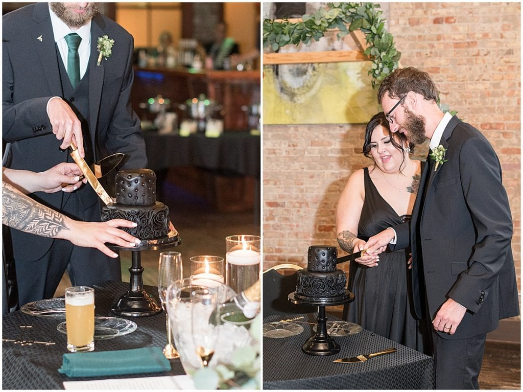 Bride and groom cut black wedding cake at eMbers Venue wedding reception