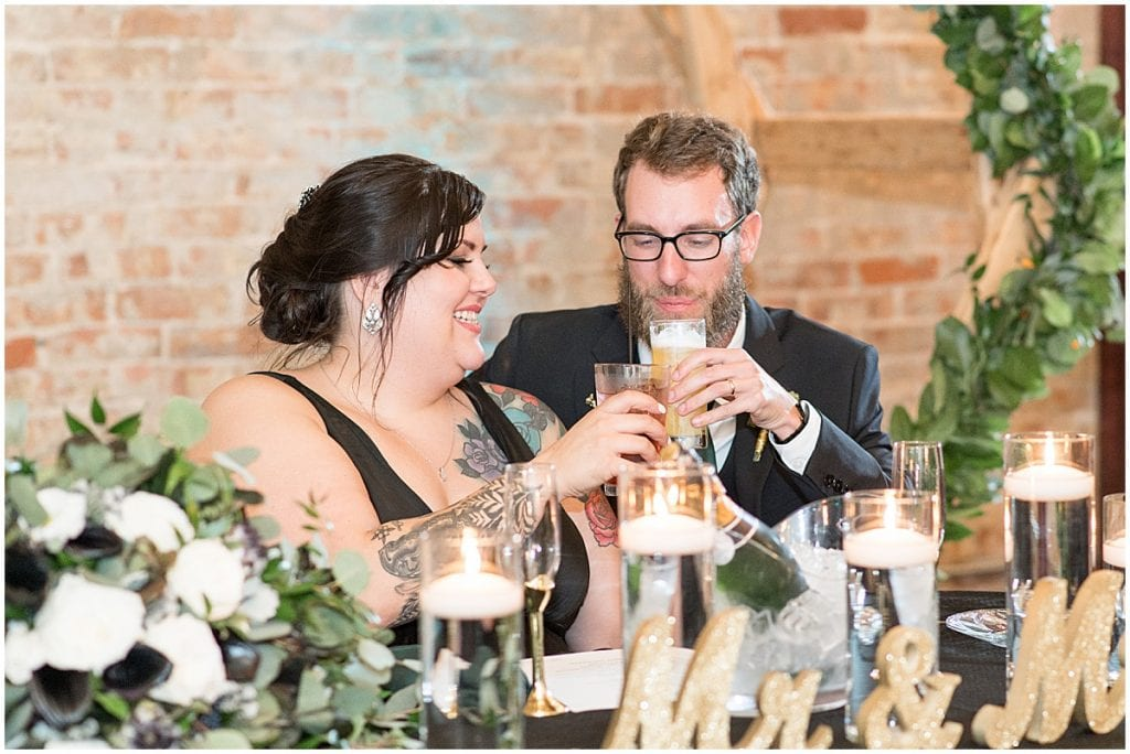 Bride and groom cheers at eMbers Venue wedding recpetion