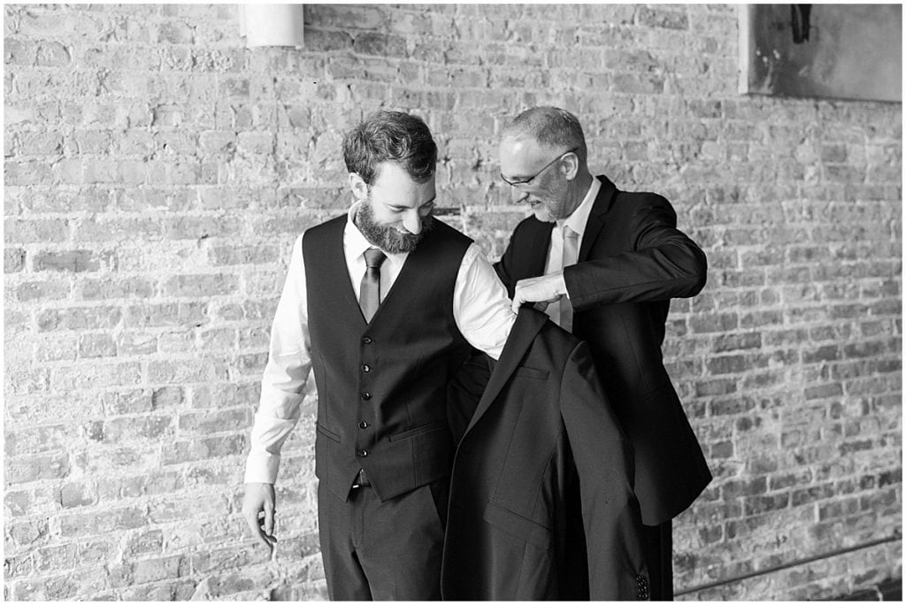 Father of groom helps groom get ready for eMbers Venue wedding