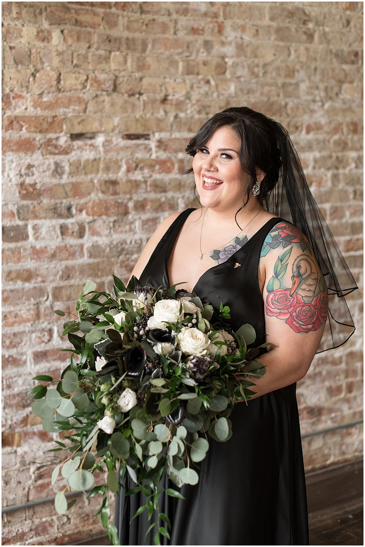 Bride wearing black wedding dress and veil for eMbers Venue wedding