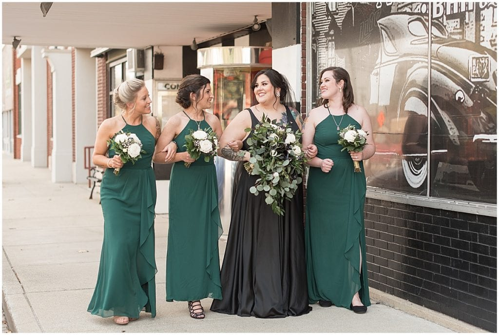 Bride wearing black wedding dress walking in Rensselaer, Indiana