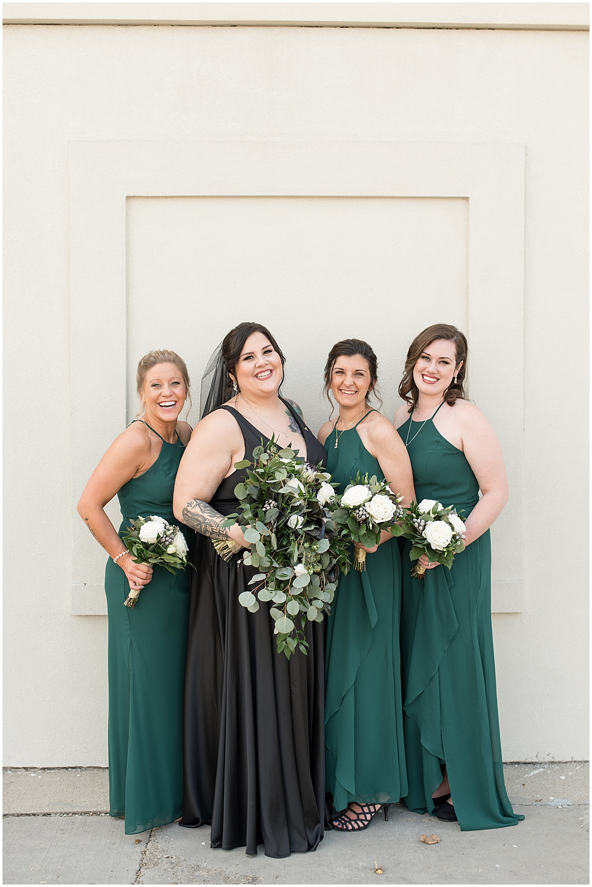 Bride wearing black wedding dress hanging with her bridesmaids