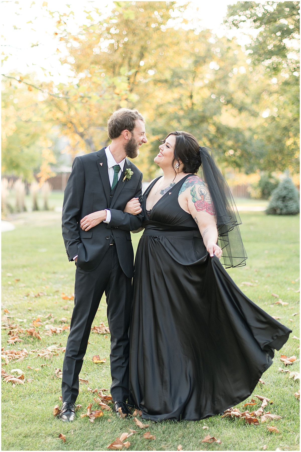 Bride and groom portraits with bride wearing a black wedding dress