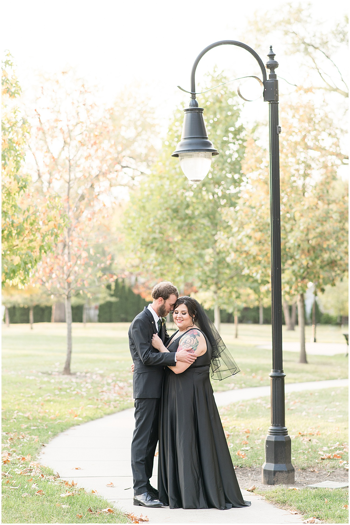 Bride wearing black wedding dress for just married portraits