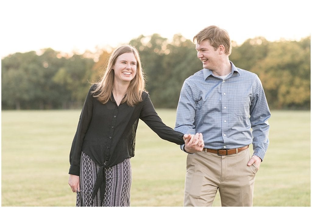 Engaged couple holding hands at Ross Hills Park in West Lafayette, Indiana