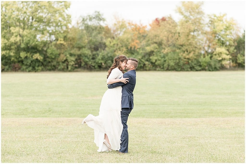 Bride and groom kiss after ceremony in Lafayette, Indiana