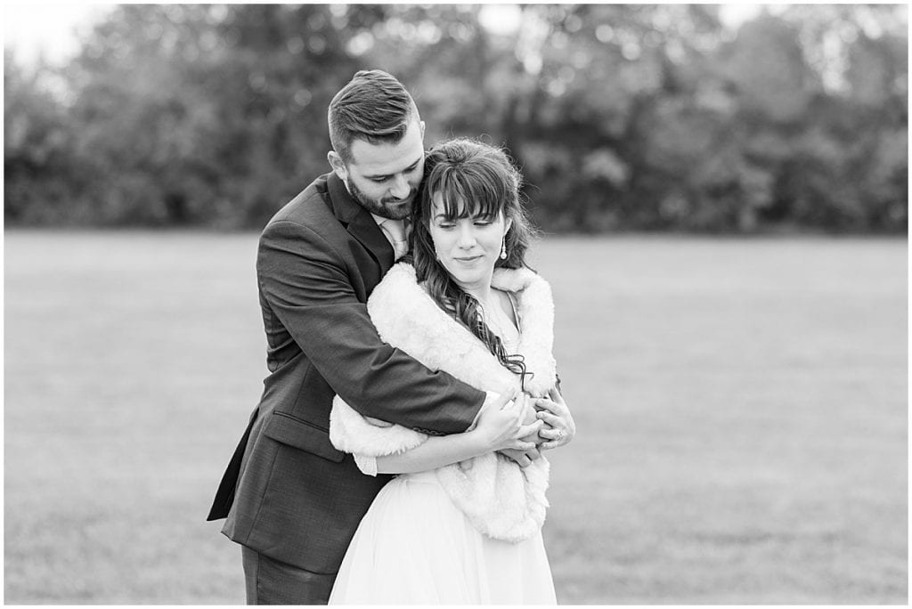 Groom hugs bride after fall wedding in Lafayette, Indiana