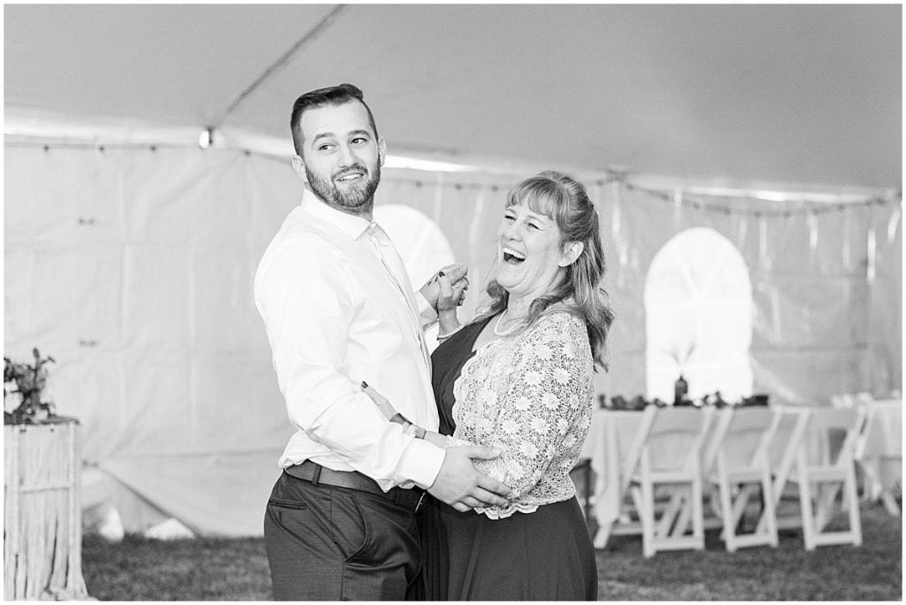 Mother of the groom and groom dance during reception in Lafayette, Indiana