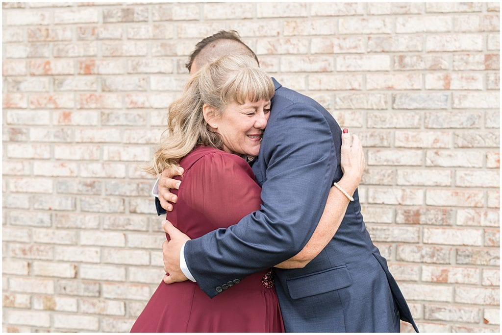 Mother of the groom hugs groom before wedding ceremony in Lafayette, Indiana