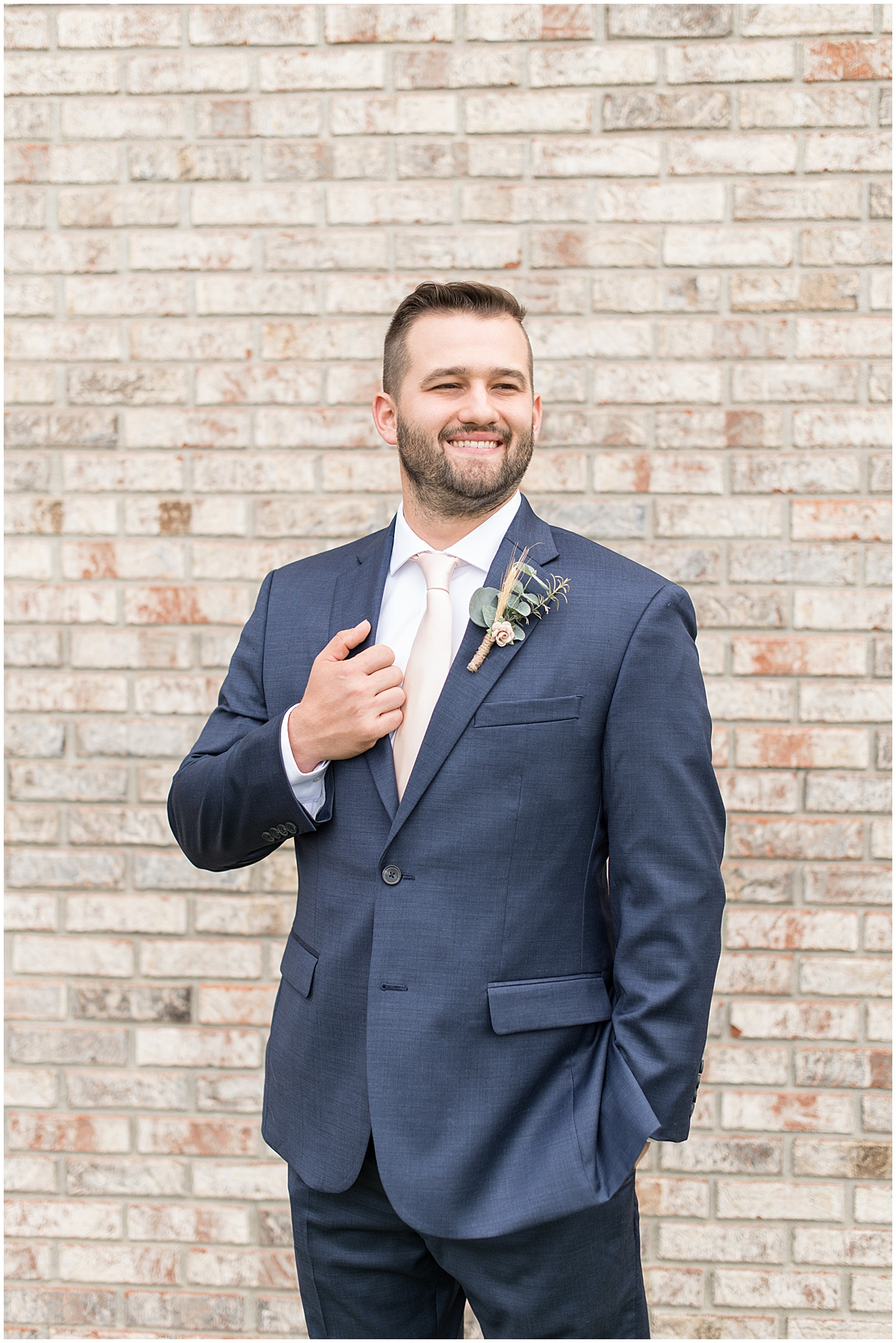 Groom portraits outside Innovation Church in Lafayette, Indiana