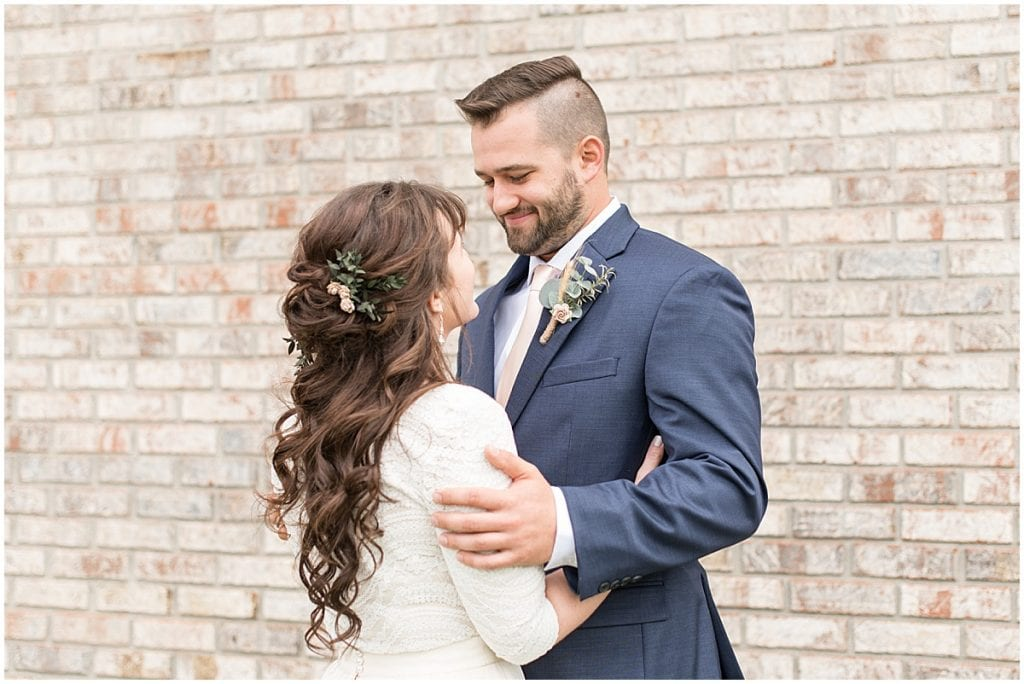 Groom admires bride after their first look outside of Innovation Church