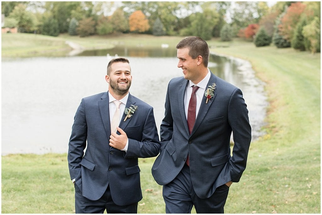 Groom and best man next to pond before wedding in Lafayette, Indiana