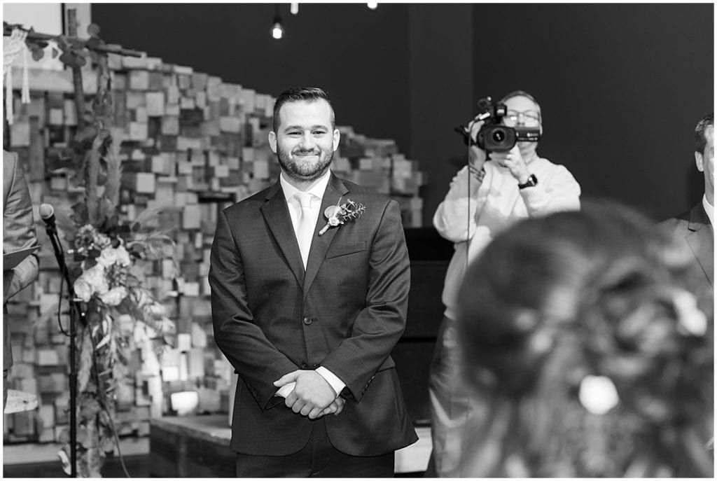 Grooms reaction to bride during wedding at Innovation Church in Lafayette, Indiana