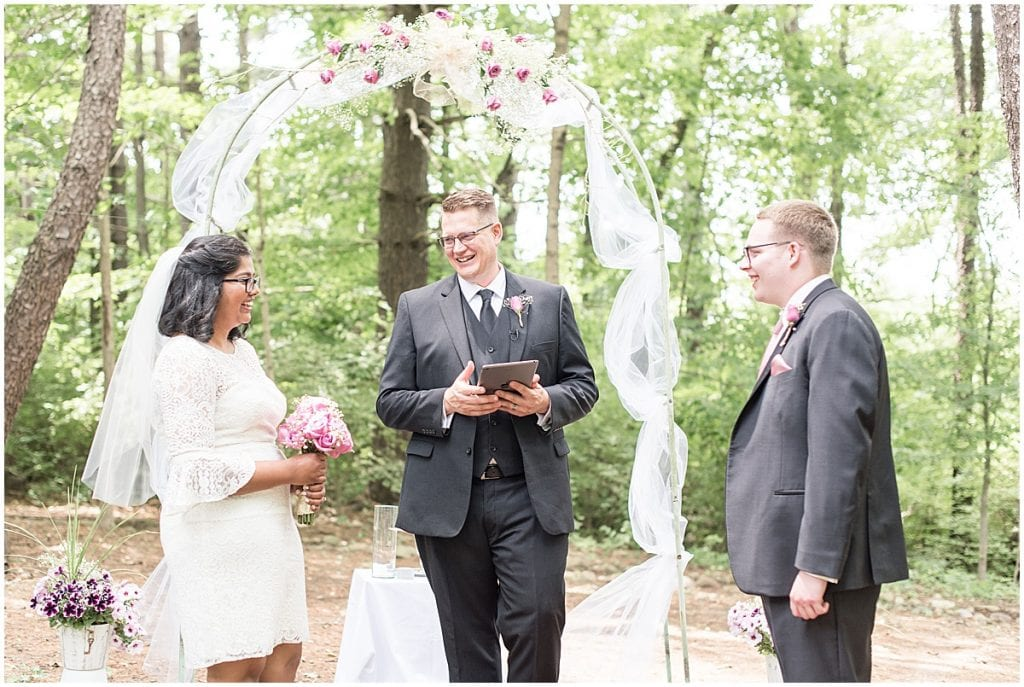 Exchanging vows during COVID backyard wedding in West Lafayette, Indiana by Victoria Rayburn Photography