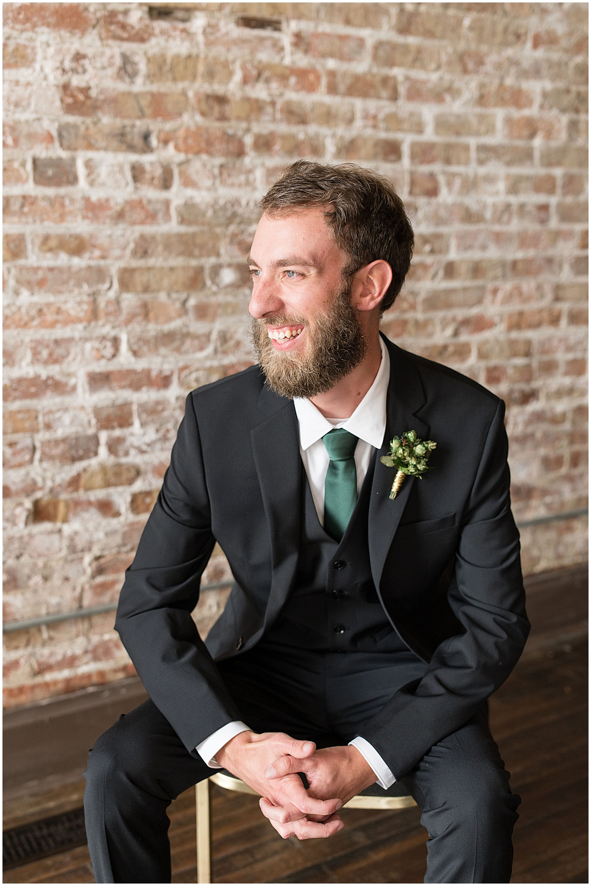 Groom ready for eMbers Venue wedding in Rensselaer, Indiana with a bride wearing black by Victoria Rayburn Photography