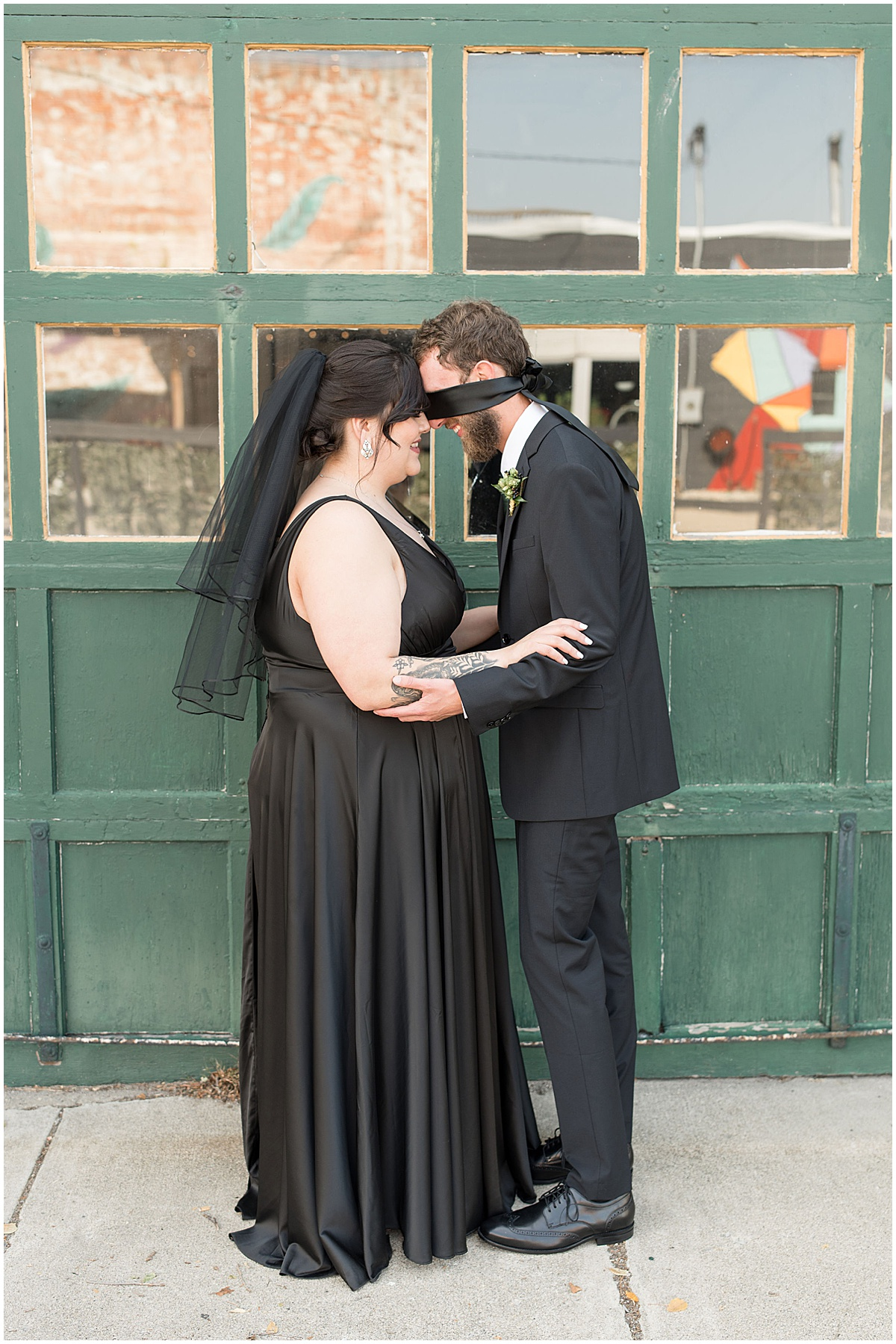 First touch before eMbers Venue wedding in Rensselaer, Indiana with a bride wearing black by Victoria Rayburn Photography
