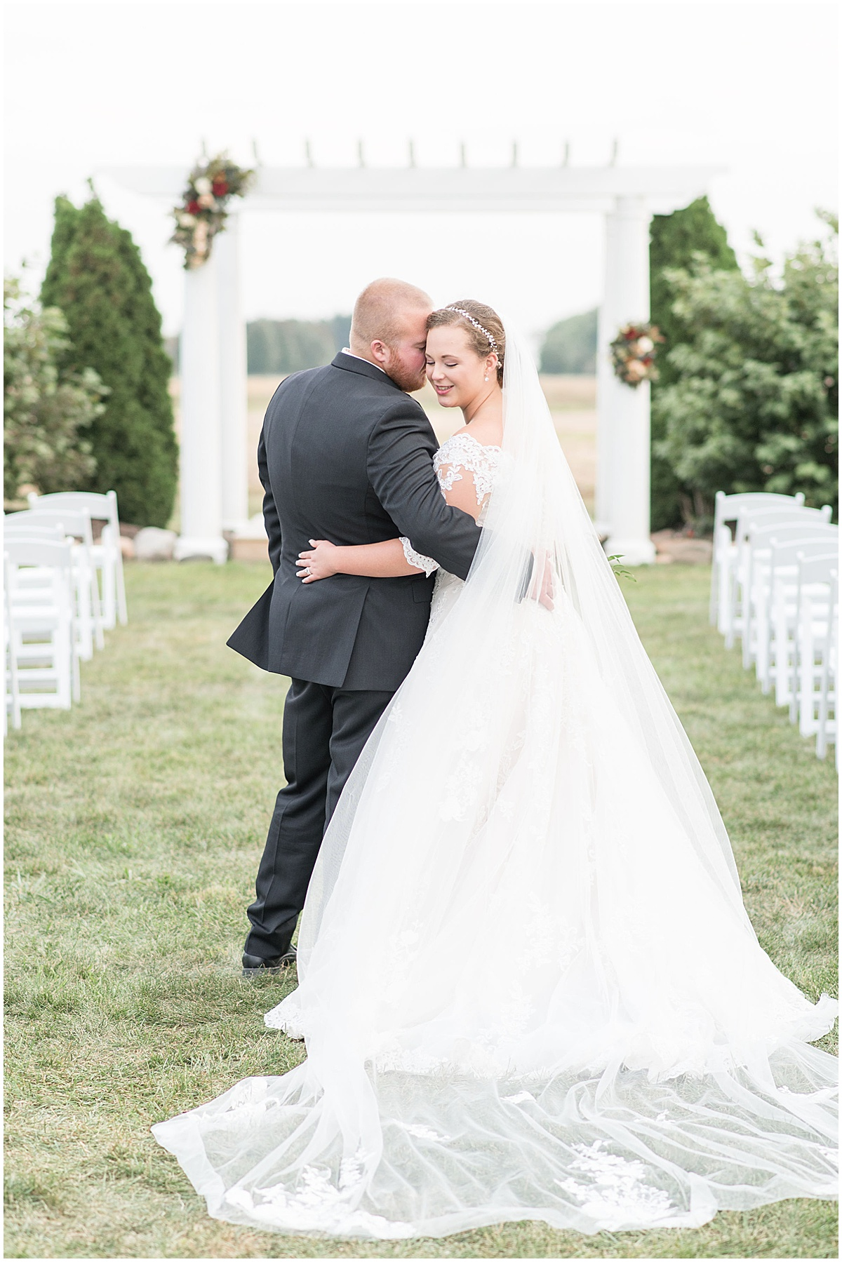 Just married photos after Meadow Springs Manor wedding in Francesville, Indiana by Victoria Rayburn Photography
