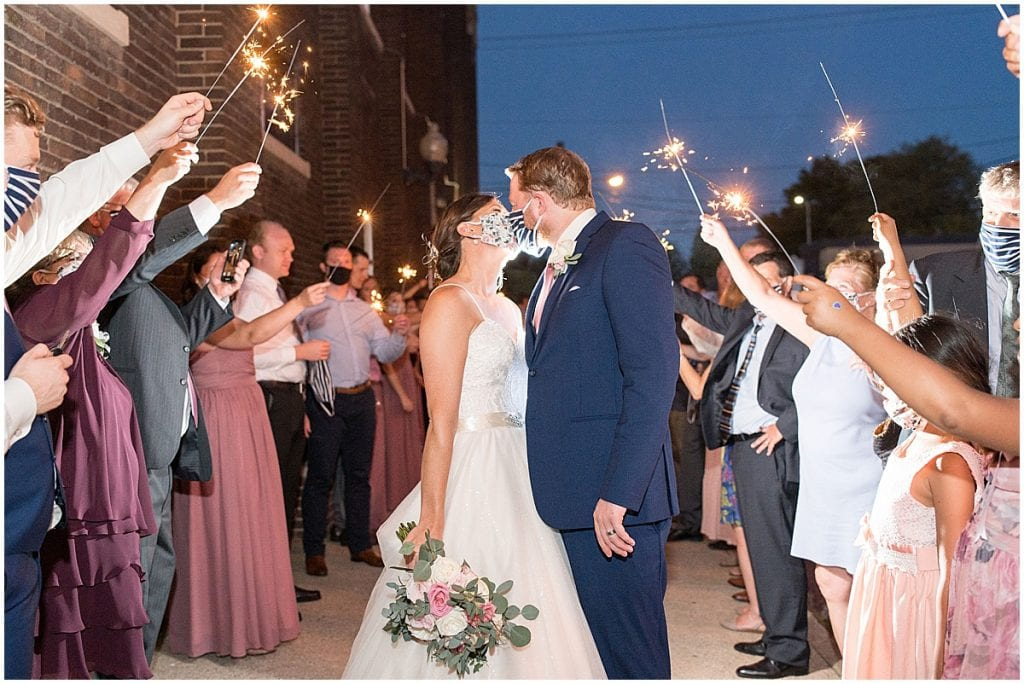 Grand exit after Spohn Ballroom wedding in Goshen, Indiana by Victoria Rayburn Photography
