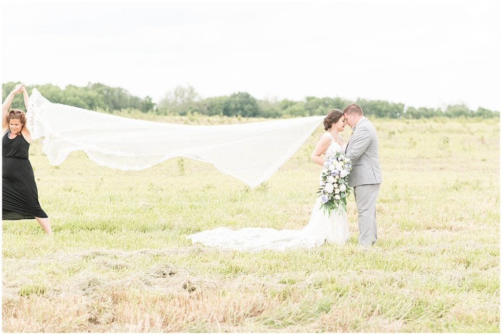 Megan Kendall tossing veil for veil shot for Victoria Rayburn Photography