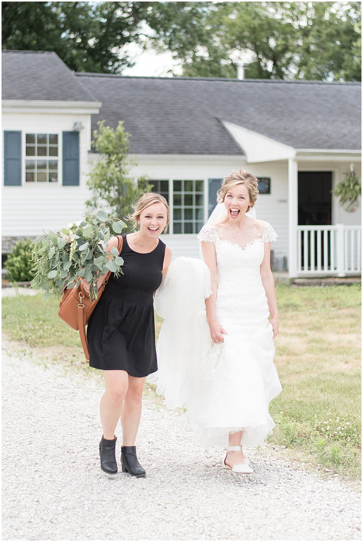 Lafayette, Indiana wedding photographer Victoria Rayburn carrying a bride's dress