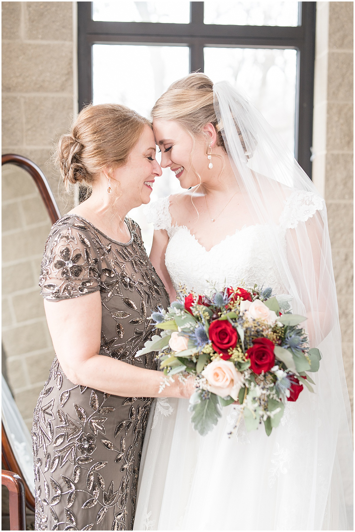 Bride and her mother before winter wedding in Lafayette, Indiana