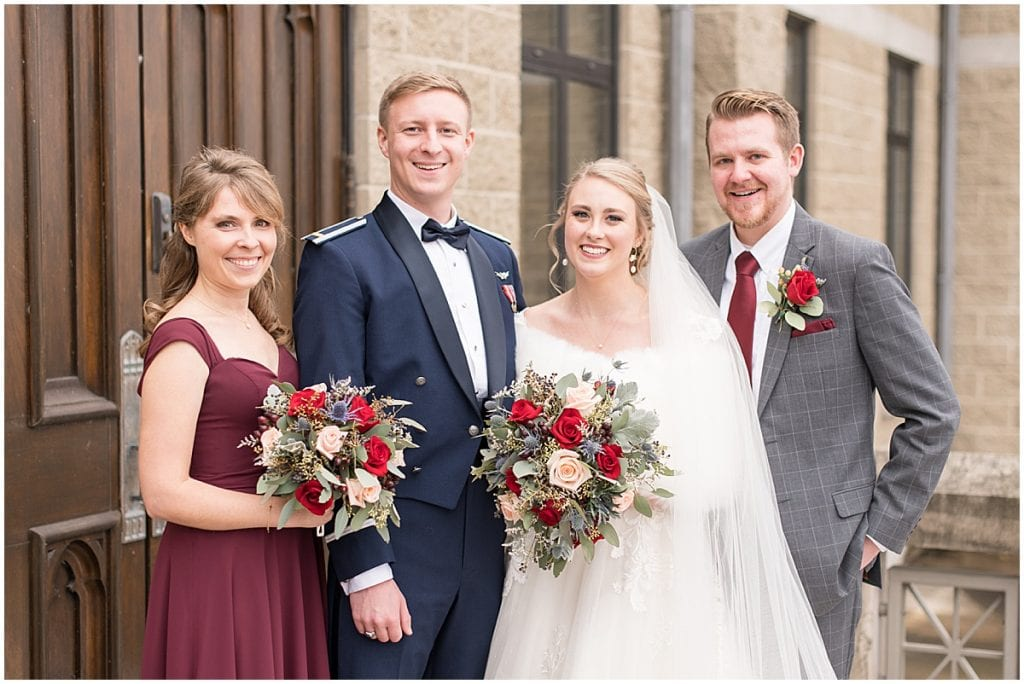 Bridal party outside winter wedding at the Cathedral of Saint Mary