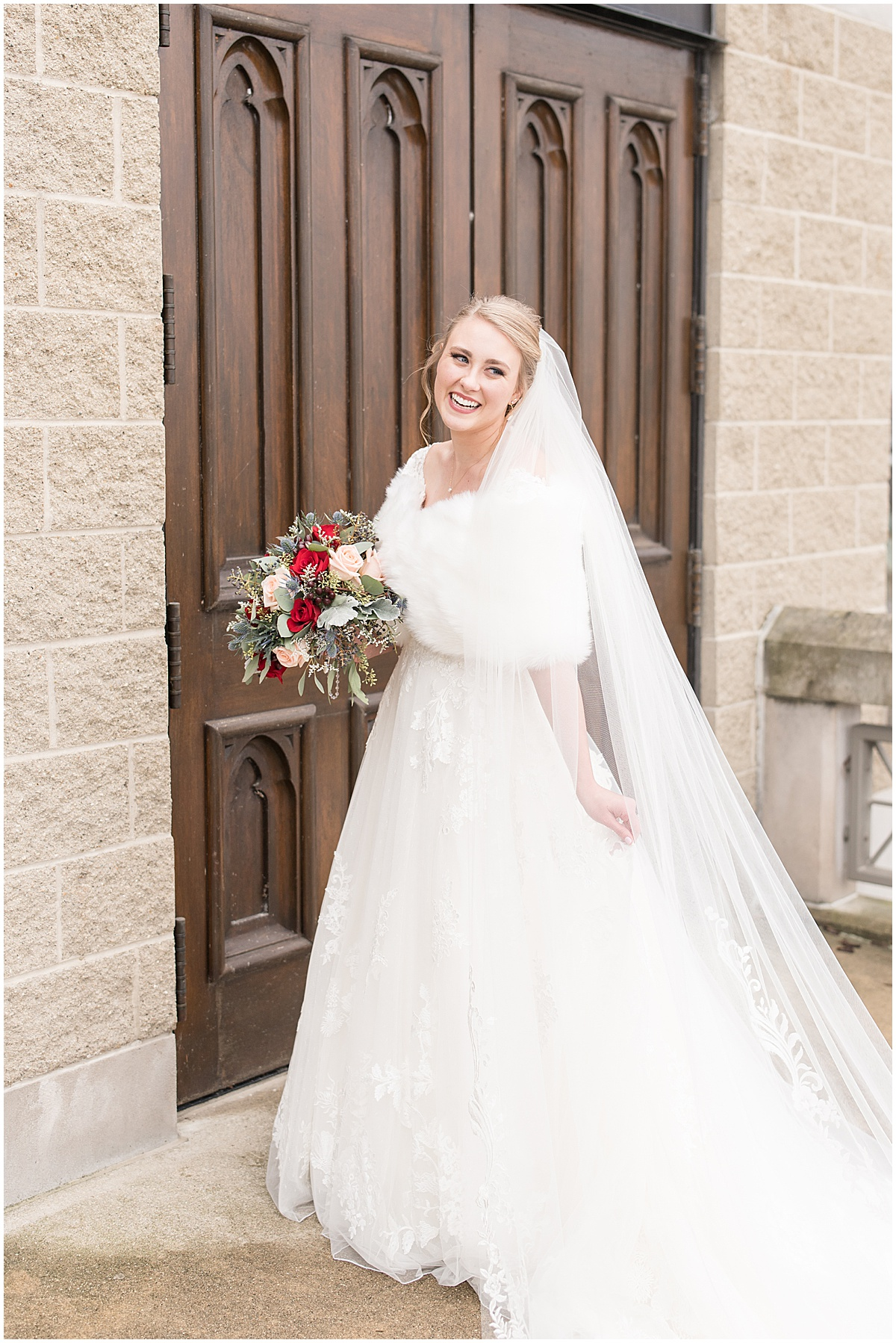 Bride at winter wedding at the Cathedral of Saint Mary in Lafayette, Indiana