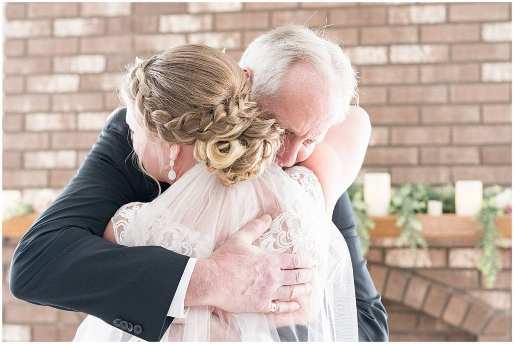 Father of the bride first look before at-home, socially distanced wedding