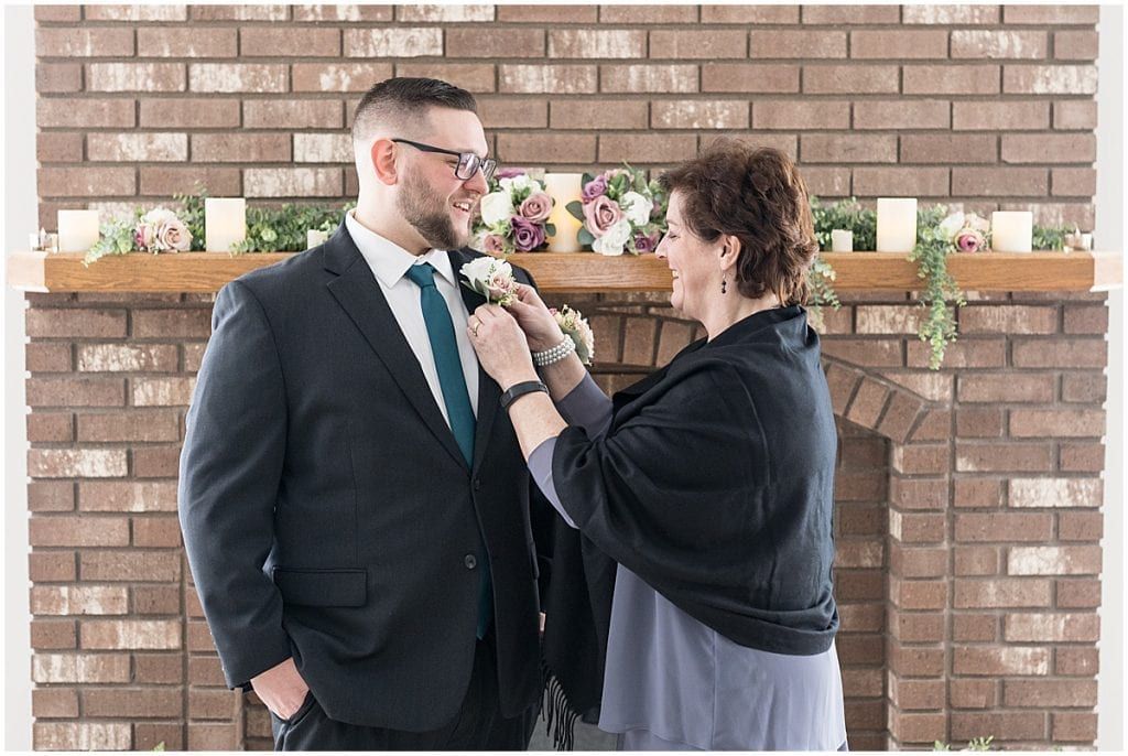 Groom getting ready for at-home, socially distanced wedding in Tinley Park, Illinois