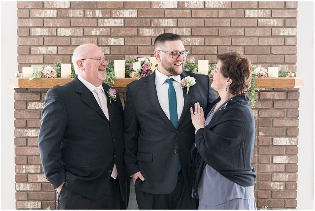 Groom enjoying time with parents before at-home, socially distanced wedding in Tinley Park, Illinois