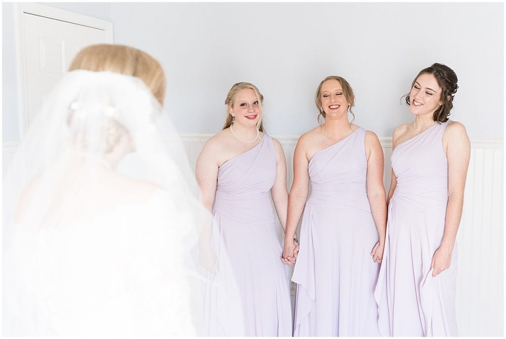 Bridesmaids first look at Traders Point Creamery wedding in Zionsville, Indiana