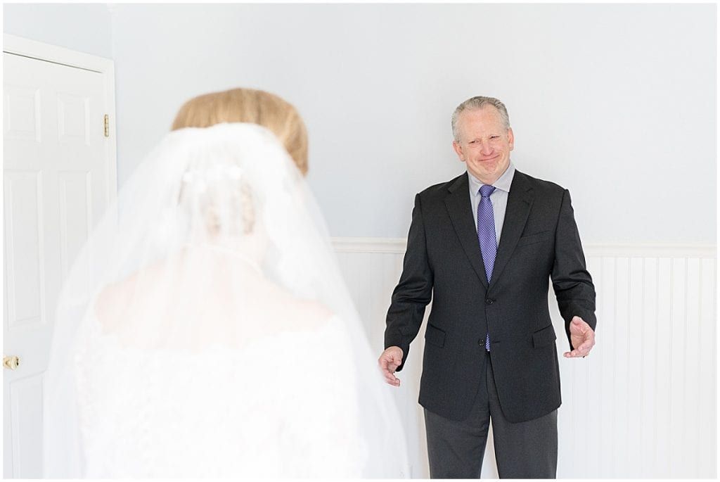 Bride's first look with father before Traders Point Creamery wedding in Zionsville, Indiana