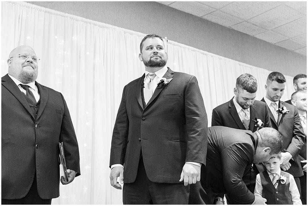 Groom's reaction to bride walking down the aisle at a wedding at The Brandywine in Monticello, Indiana