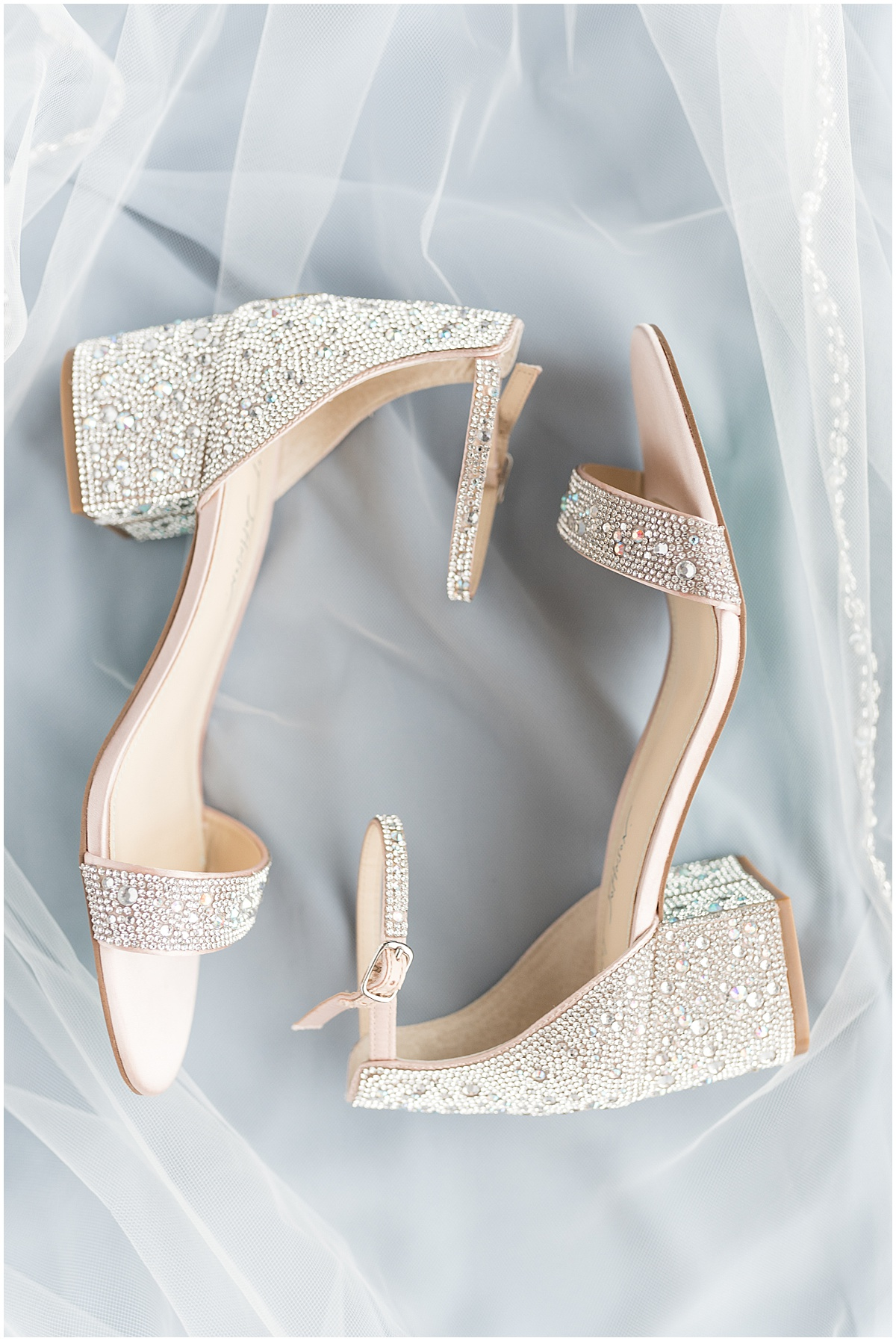 Bride's shoes at a wedding at The Brandywine in Monticello, Indiana