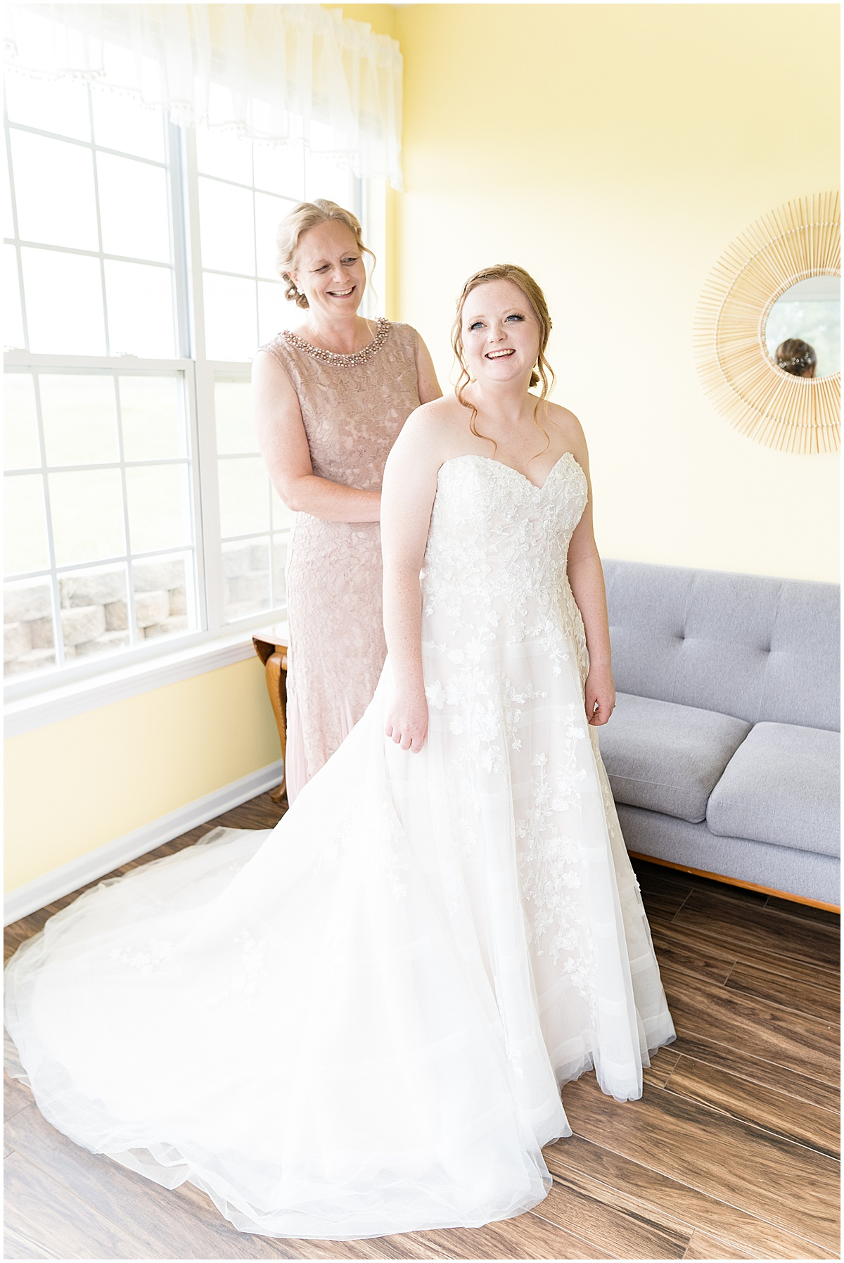 Bride getting ready for County Line Orchard wedding in Hobart, Indiana with her mom's help