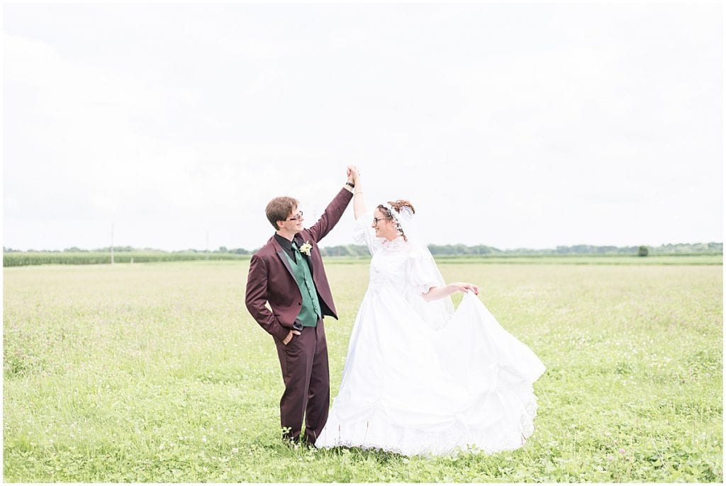 Bride and groom dance before Exploration Acres wedding in Lafayette, Indiana