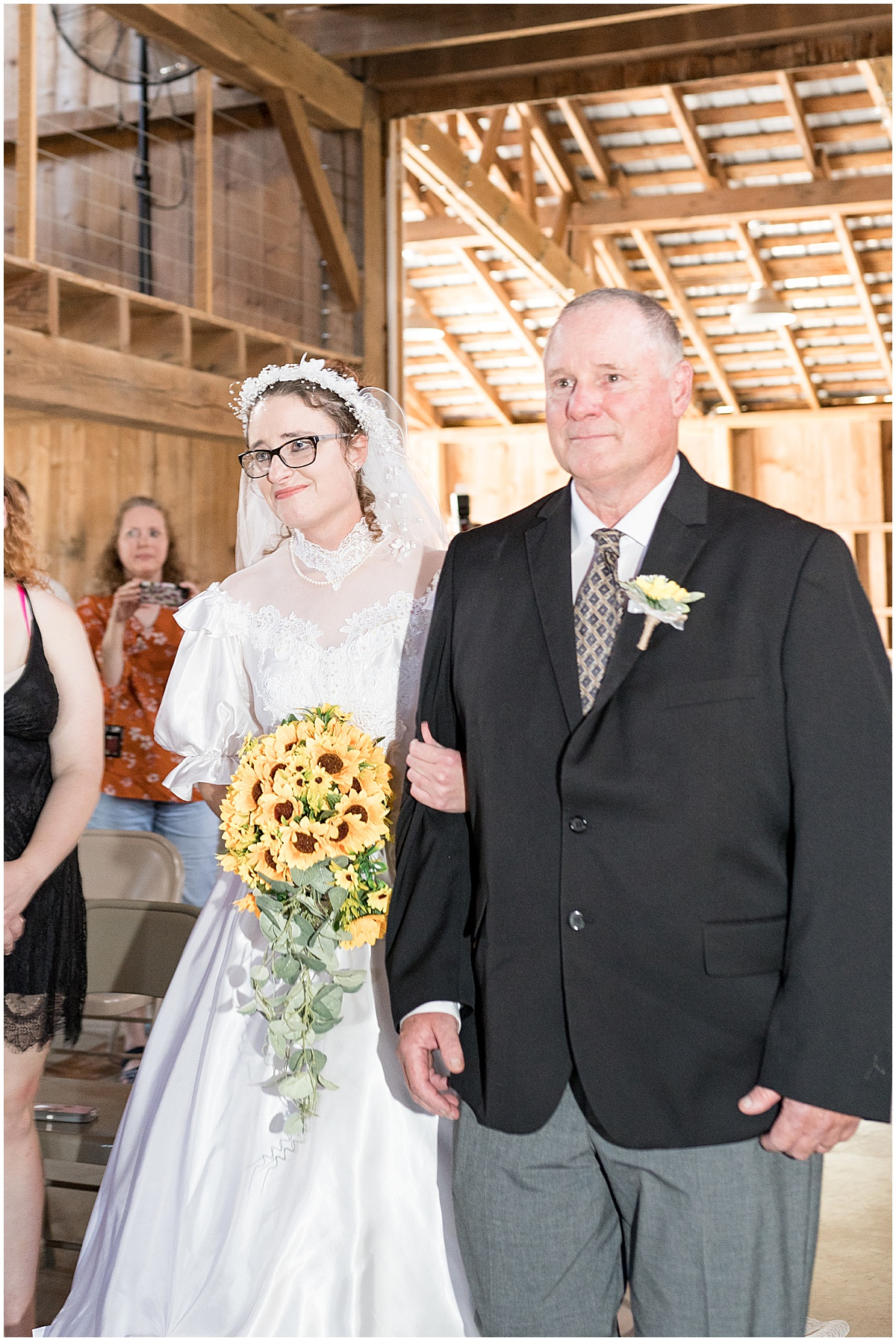 Bride walking down aisle at Exploration Acres wedding in Lafayette, Indiana