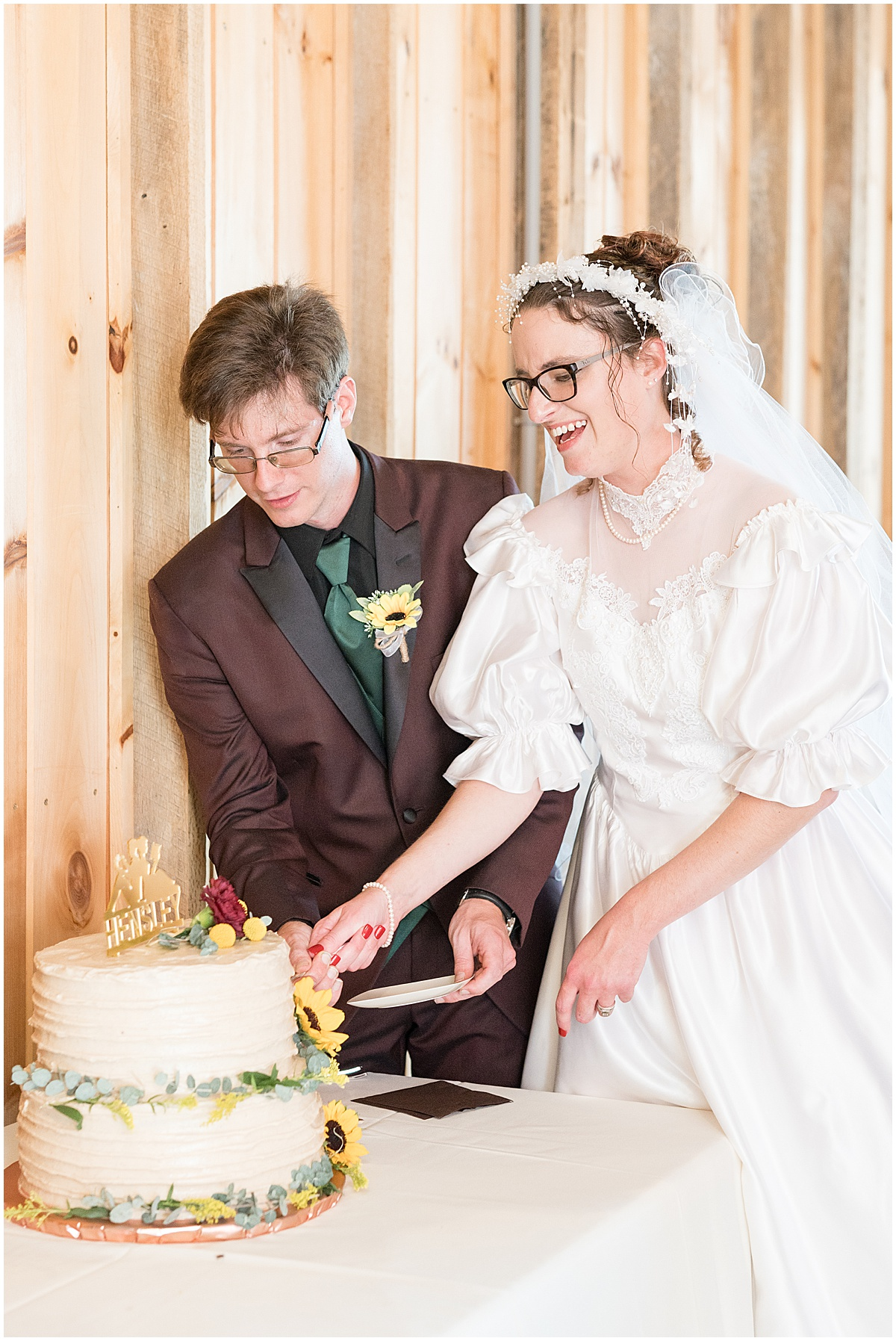 Bride and groom cutting cake at Exploration Acres wedding in Lafayette, Indiana