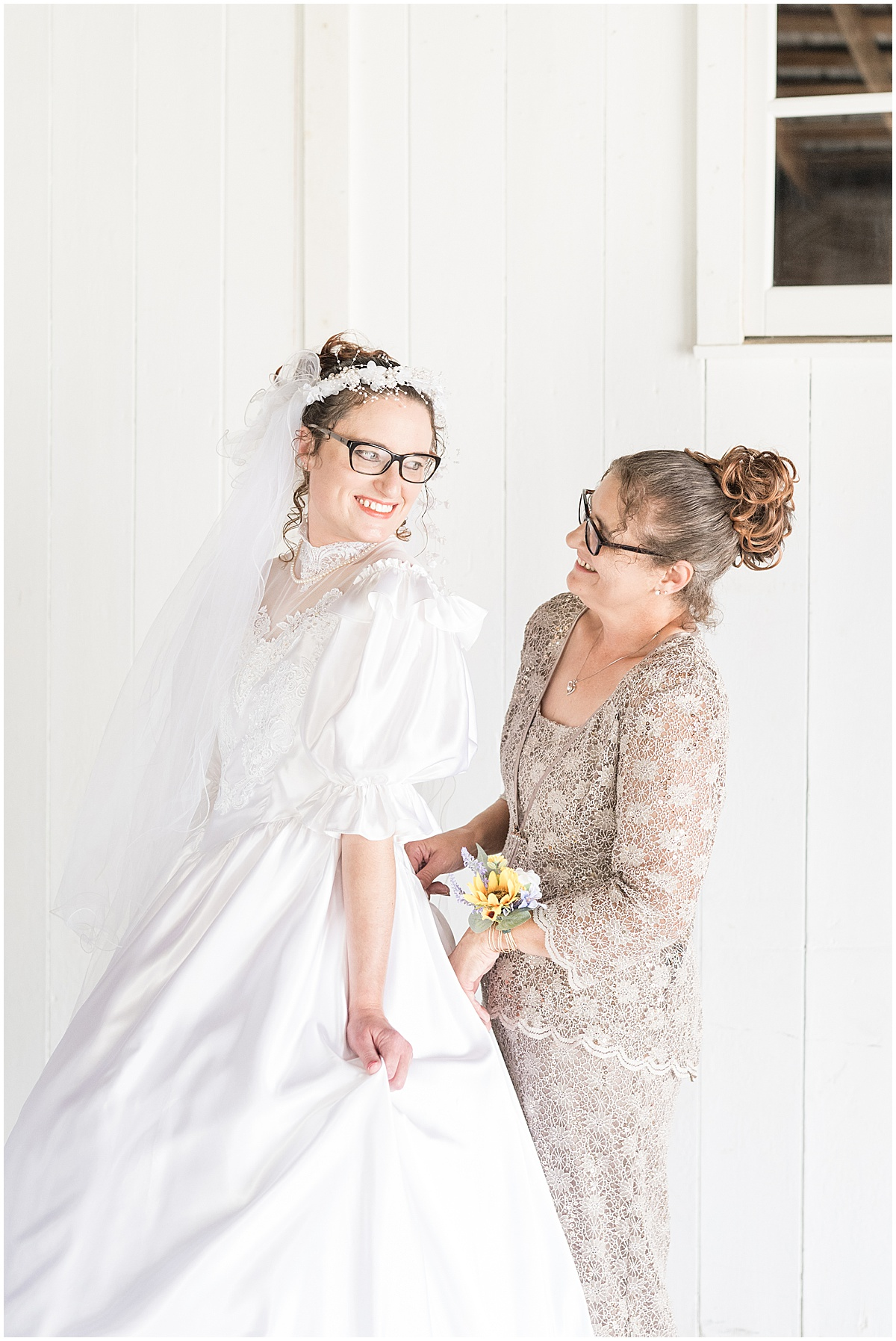 Bride getting ready in mother's wedding dress for Exploration Acres wedding in Lafayette, Indiana