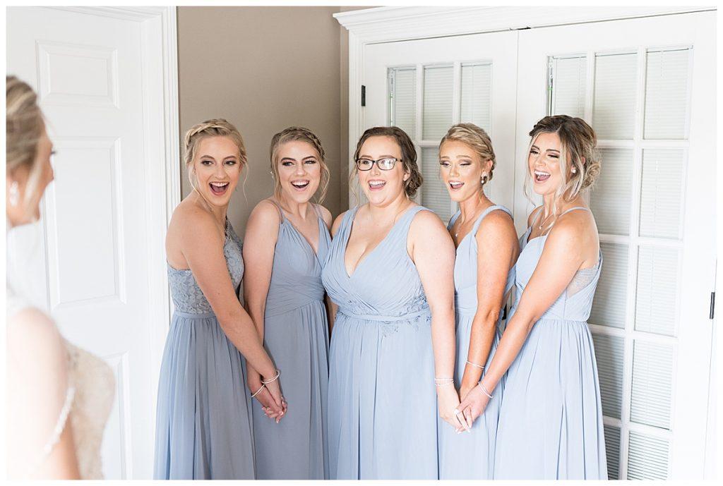 Bridesmaids reaction to bride before Gathering Acres Wedding