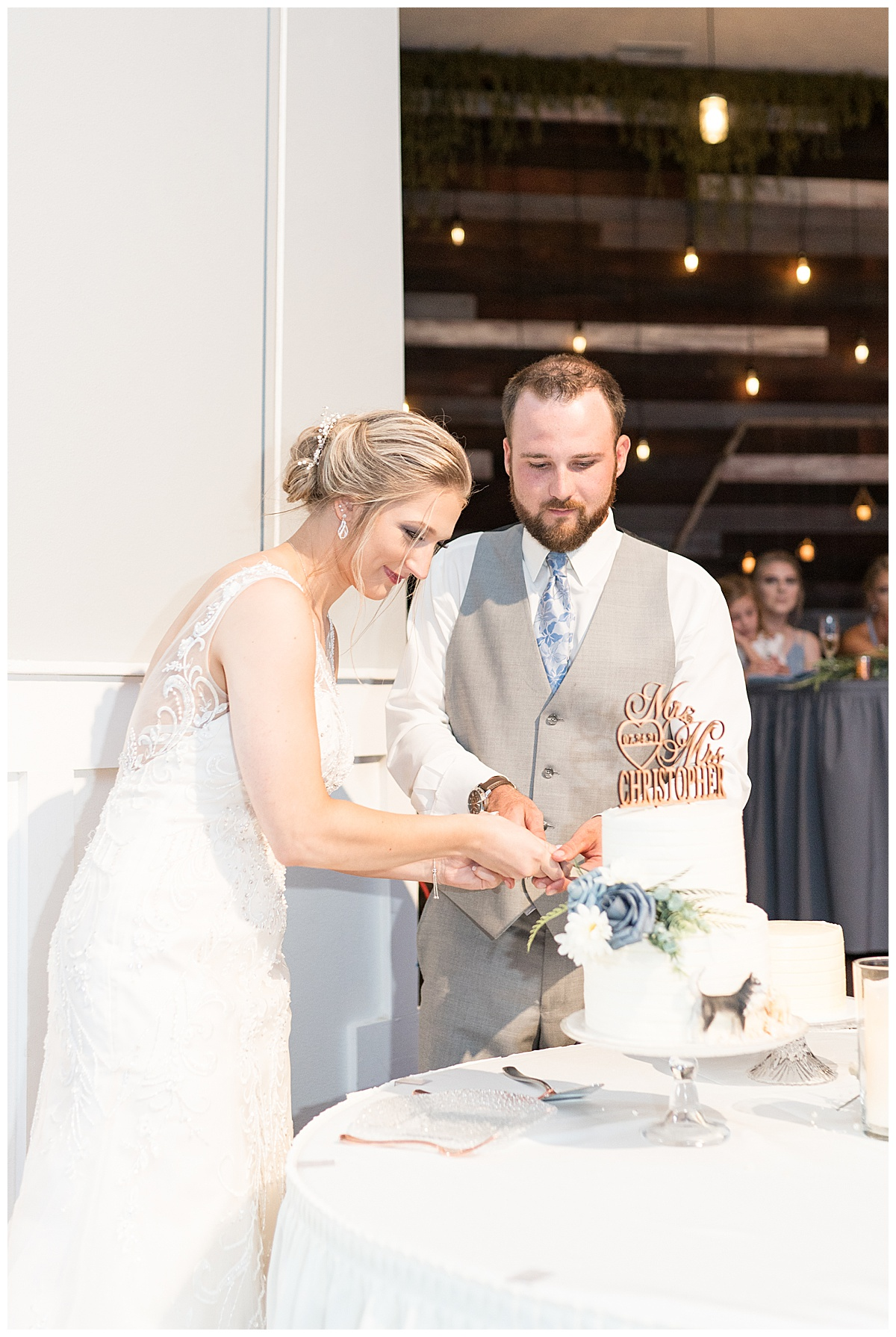 Cake cutting at Gathering Acres wedding reception in Lafayette, Indiana
