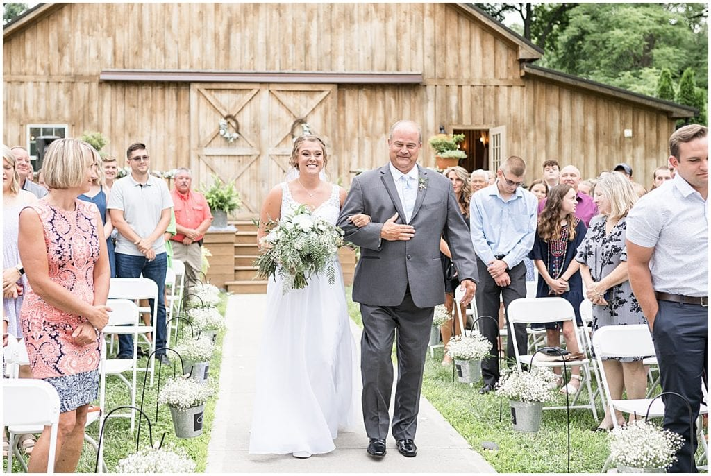 Dad walking bride down aisle at Hawk Point Acres Wedding in Anderson, Indiana