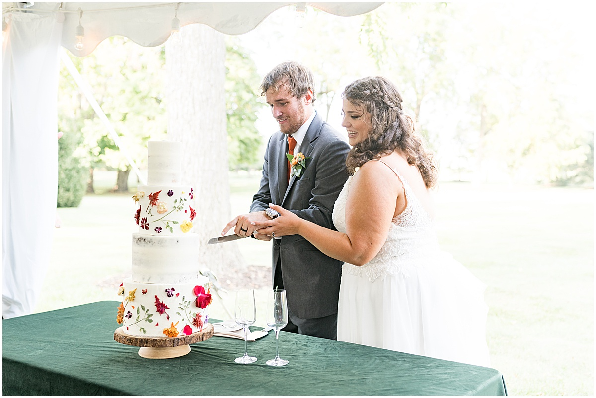 Cake cutting at outdoor private property wedding in Frankfort, Indiana by Victoria Rayburn Photography