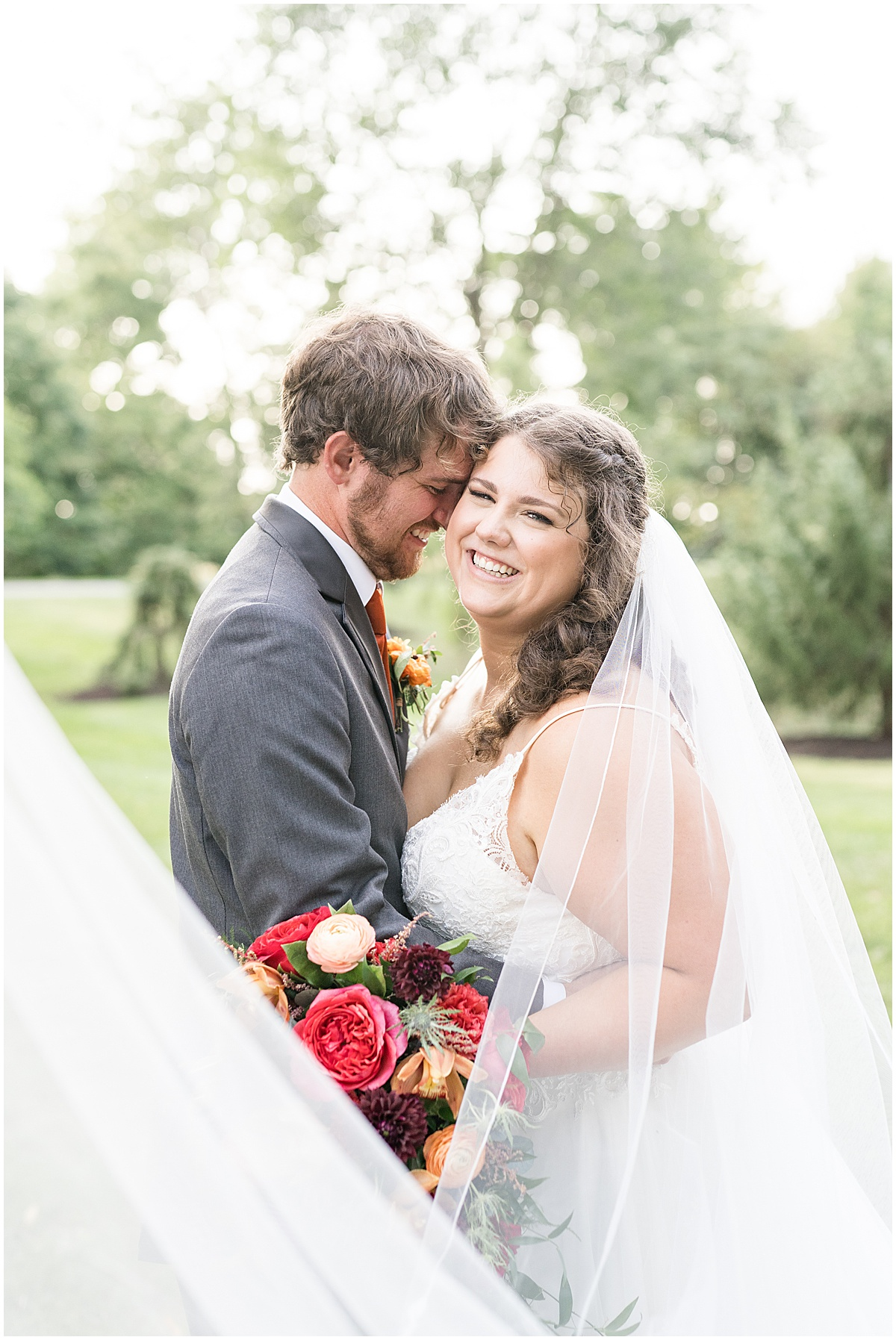 Bride and groom photo during outdoor private property wedding in Frankfort, Indiana by Victoria Rayburn Photography