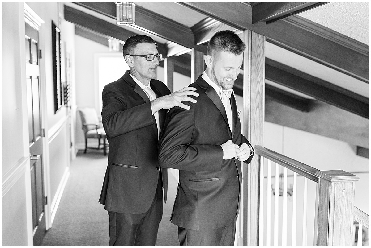 Groom getting ready for wedding at The Edge in Anderson, Indiana