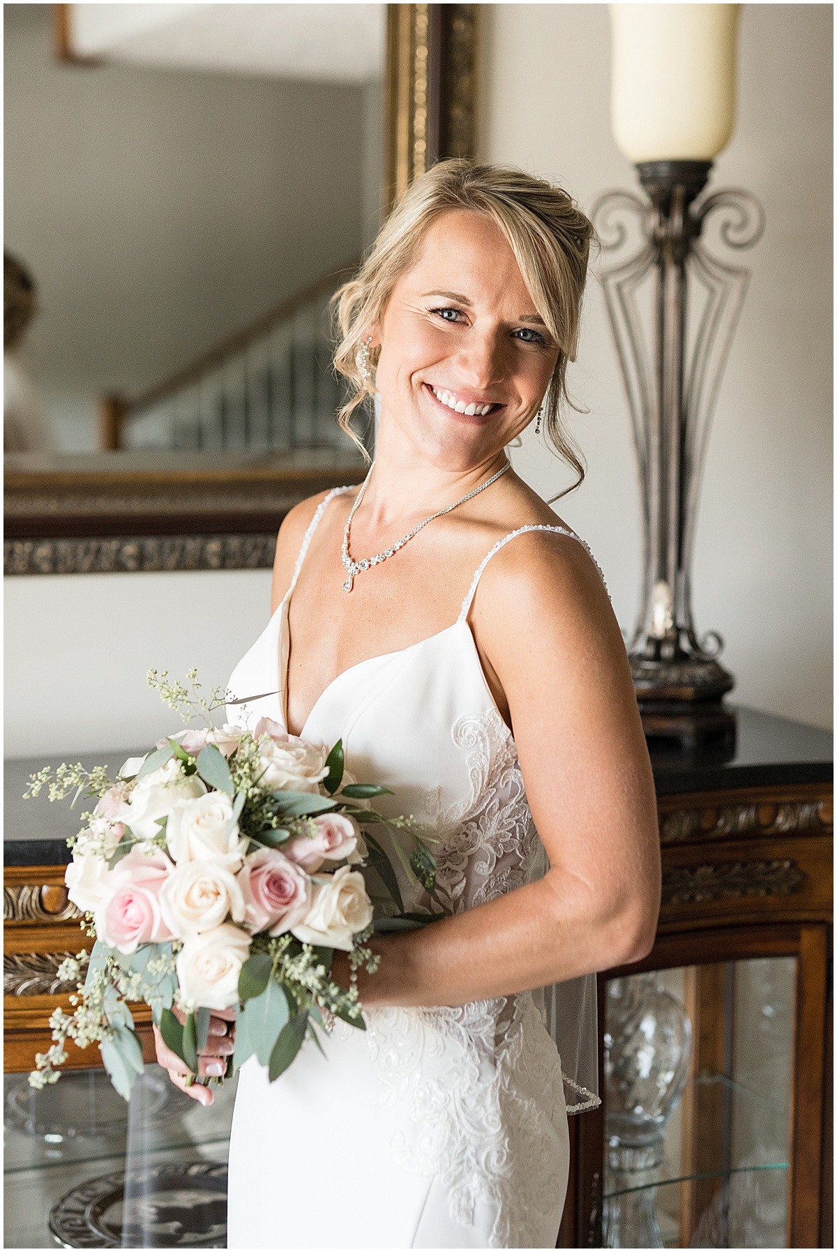Bride getting ready for wedding at The Edge in Anderson, Indiana
